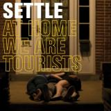 chronique Settle - At Home We Are Tourists